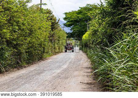 Tractor At An Unpaved Rural Road At El Cerrito In The Valle Del Cauca Region In Colombia