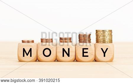 Money Concept. Wooden Blocks With Text Money And Coins On Wooden Table. Copy Space