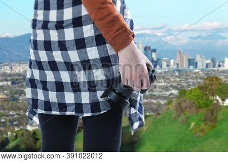 Female Photographer Or Tourist Hiking Solo As A Social Distance Activity Outdoors With A Camera And