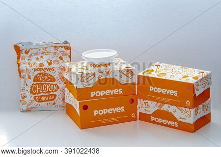 Calgary, Alberta, Canada. Oct 22, 2020. Popeyes Boxes Of Chicken, Burgers, Cole Salad And Fries On A