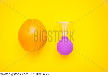 Bright Oranges And A Jar For Anti-cellulite Massage. Healthy Lifestyle Concept. Cellulite, Diet, Ora