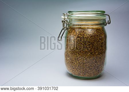 Glass Jar With Buckwheat On A White Background, Side View. The Concept Of Healthy Nutrition, Diets,