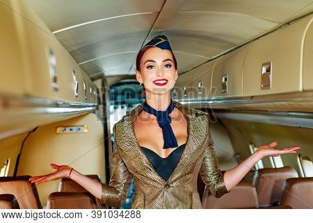 Young Woman In Flight Attendant Clothes. Happy Smiling Woman Stewardess In Uniform Waiting For Her F