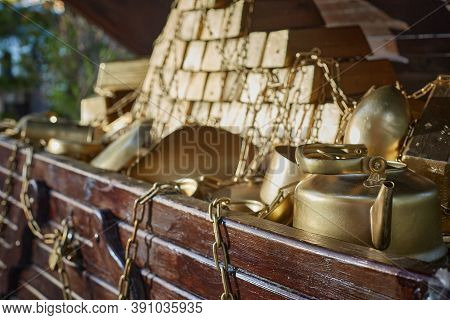 Open Treausre Chest Of Gold. Gold Teapot, Gold Bars And Gold Chains