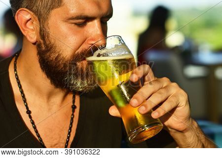 Happy Elegant Man Drinking Beer. Beard Man Drinking Beer From A Beer Mug. Bearded Man With A Glass O