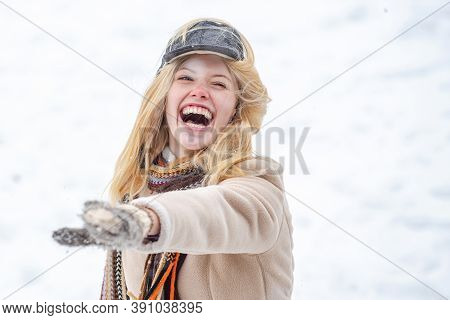 Young Excited Girl Playing Snowball Fight. Happy Woman Holds Snowball In Hands. Portrait Of A Happy