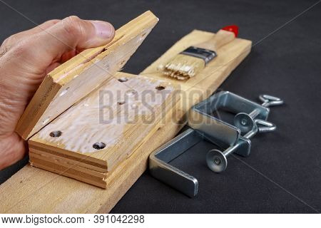 Gluing Pieces Of Wood With Carpentry Glue. Minor Carpentry Work In The Workshop.