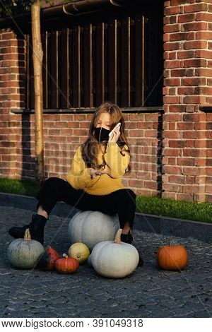 Kids Trick Or Treat In Halloween Costume And Face Mask. Coronavirus Halloween. Child Celebrates Holi
