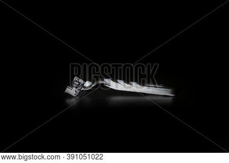 Gillette Mach 3 Razor On Black Background In Low Key Light