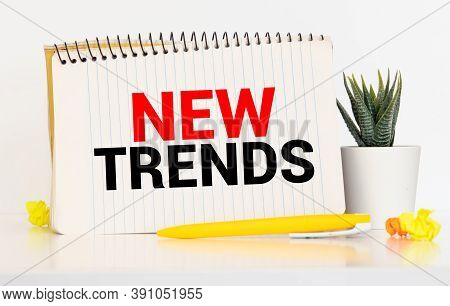 New Trends Text Written On Notebook With Glasses, Magnifier End Pen. Main Trend Of Changing Somethin