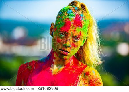 Color Young Woman Face With Colorful Holi Splash. Fashion Girls On Holi Color Festival