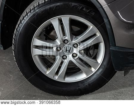 Novosibirsk, Russia - October 16, 2020: Honda Cr-v, Car Wheel With Alloy Wheel And New Rubber On A C