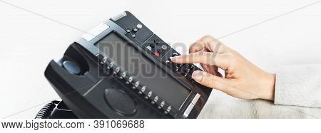 Business And Communications. Using Voip Phone In The Office, Close Up Of Hand With Receiver. Confere
