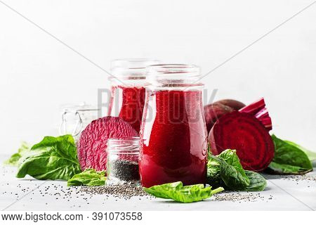 Healthy And Healthy Detox Smoothies Or Juice From Raw Beets And Spinach With Chia Seeds In Glass Bot
