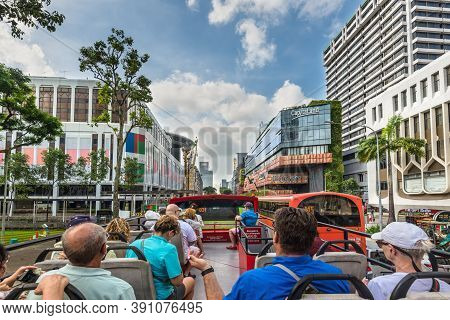 Singapore - December 4, 2019: People Look At The Sights Of Singapore By Hop-on Hop-off Bus - Go Alon