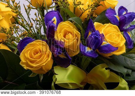 Beautiful Floristic Bouquet Of Blue Irises And Yellow Roses