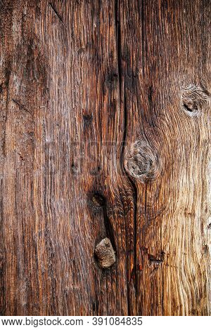 Close Up Of Worn Weathered Barn Board With Cracks And Knots.
