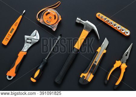 Set Of Tools On Black Background. Construction, Diy Concept. Equipment,  Workplace. Flat Lay Composi