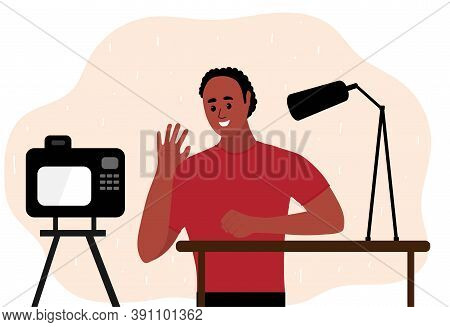 African Black Man Blogger Make Video Tutorial. Male Podcaster Talking To Camera Using Microphone. Ve