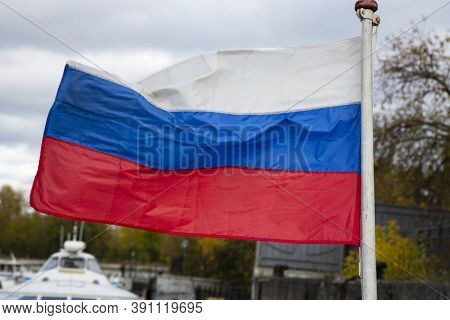 The Russian Flag, Growing In The Wind. Flag Of The Russian Federation
