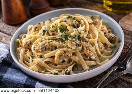A Plate Of Delicious Pasta With Clam Sauce With Onion, Garlic, Olive Oil, Parsley And Fresh Clams.