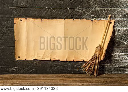 Blank Manuscript With Place For Text And Witchs Broom For Flying On Dark Background