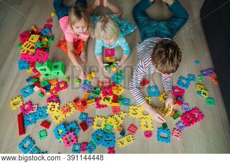 Kids Playing With Pouzzle And Plastic Blocks, Family Staying Home,