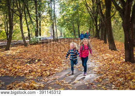 Happy Kids With Grandmother Walk In Autumn Nature