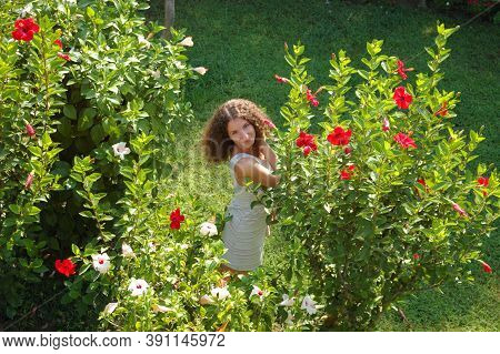Young Curly Girl, Among Flowers, Tourism, Recreation Vacation Green Glade