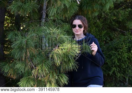Young Curly Girl, Glasses, Forest, Cedar Branch Vacation Summer Day