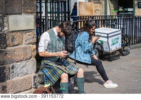 Edinburgh, Scotland, August 18th 2019. A Young Man Dressed In National Scottish Clothes And A Kilt U