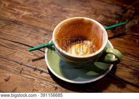 Close Up Of Empty Cup Coffee After Drink On Wooden Table