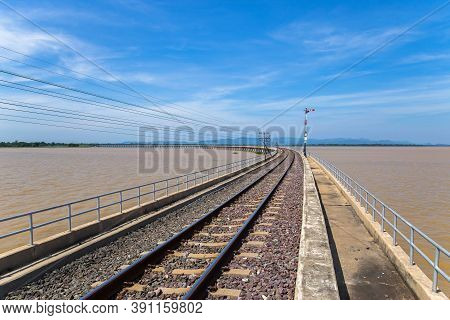 Railway Track Leading Across The Lake In Thailand