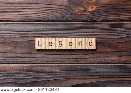 Legend Word Written On Wood Block. Legend Text On Cement Table For Your Desing, Concept