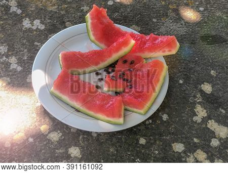 Slice Of Eaten Watermelon Close-up On White Plate On The Table. Top View. Summer Food. Healthy Eatin