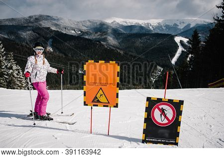 Woman Stand Skiing Near Road, Is Preparing Descend Down On Snow Track In Carpathian Mountains. On Ba