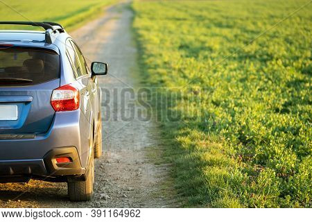 Landscape With Blue Off Road Car On Gravel Road. Traveling By Auto, Adventure In Wildlife, Expeditio