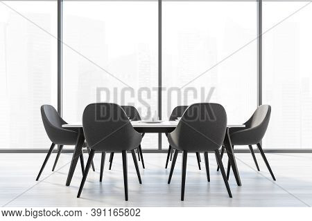 Bright Kitchen Room With A Big Window And Six Black Chairs With One White Kitchen Table. Home Interi