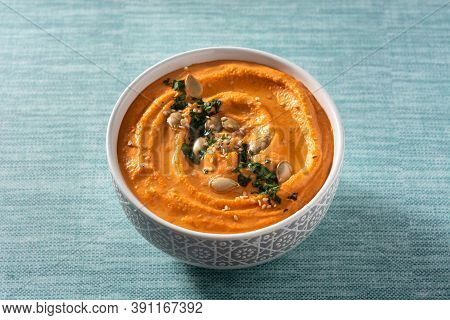Pumpkin Hummus In Bowl On Blue Background