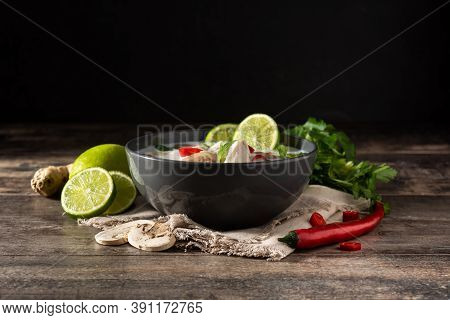 Traditional Thai Food Tom Kha Gai In Bowl And Ingredients On Wooden Table