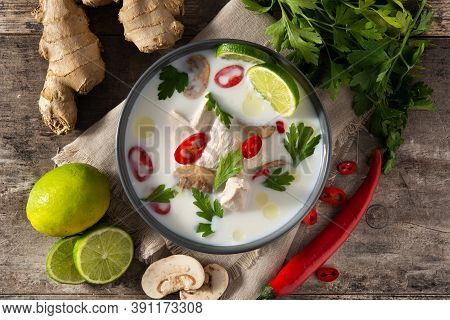 Traditional Thai Food Tom Kha Gai In Bowl And Ingredients On Wooden Table.top View