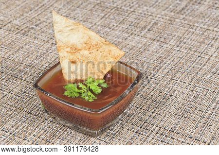 Homemade Pita Chips Dipping In Red Sauce On Rustic Fabric Background. Cooked Without Oil. Homemade D