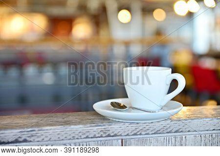 Coffee Cup In Prague Cafe 2020. Coffee Cup In Prague Cafe 2020. White Mug With Coffee On A White Sau