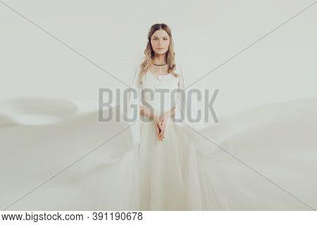 Stylish Woman In White Silky Dress Portrait