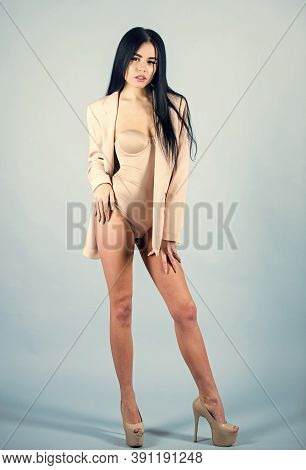 Woman Sexy Long Legs Playful Mood. Tempting Horny Woman Wear Jacket On Naked Body. Femininity And Po
