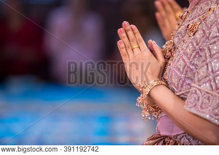 Beautiful Asian Girl To Pay Respect And Praying Buddhism Worshiping Buddha Statue With Faith. Hands