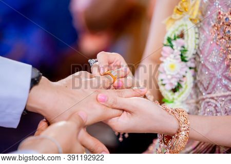 Wedding Rings. Her Put The Wedding Ring On He. Close Up  Bride Put The Ring On Groom. Thai Wedding C