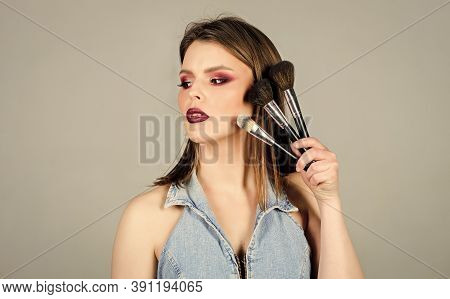 Sexy Woman With Professional Make Up Brush. Beauty Hairdresser Salon. Lipstick And Eyeshadow. Fashio