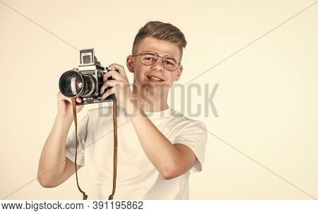 Need Closer Look. Travel Photo Concept. Boy In Casual Wear With Vintage Photo Camera. Retro Photogra
