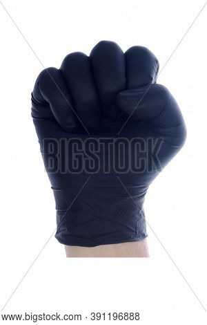 Latex Gloves. A Caucasian mans hand makes a fist while wearing a disposable Black Latex glove. Isolated on white. Room for text.